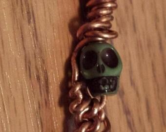 Copper Roach clip/green skull