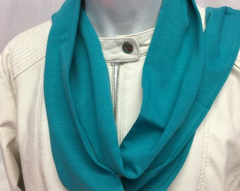Teal coat scarf give life to a old coat.