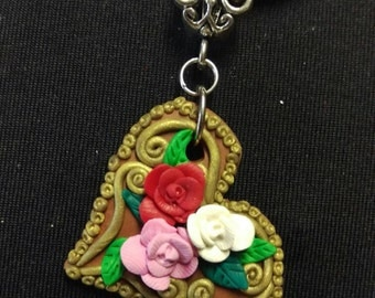 Heart with flowers pendant.polymer clay