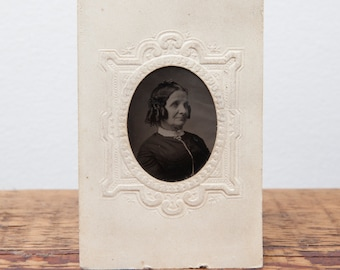 Antique Tintype of old woman in embossed paper frame.