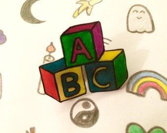 DDLG abc building blocks pin badge