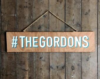 Handpainted typographic wedding hashtag sign
