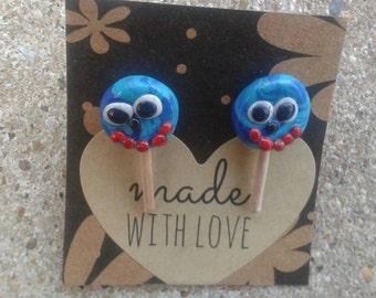 Blue lollipop smiley face clay earrings