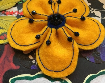 Yellow Felt flower brooch with black beads and blue stitching