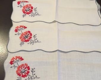 Set of 4 Beautiful Hand Embroidered Flower Napkins.