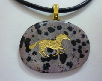Stone pendant with golden horse silhouette