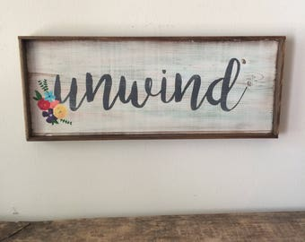 "Small wood ""Unwind"" sign"