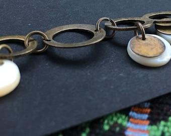 Antiqued Brass bracelet with shells.