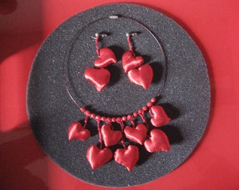 Winslow. Set in Satin Red of Choker and earrings.