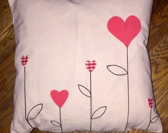 Heart stem cushion with gingham heart decoration