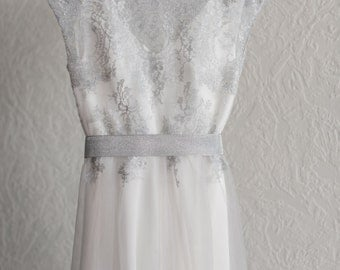 Non-corset silk wedding dress with a lace top and handmade embroidery on the shoulders