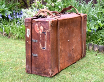 Antique Leather Suitcase U.S.A Large Trunk,leather,suitcase,luggage,shop display,steamer,train,travel,film prop,set,storage,vintage trunk,