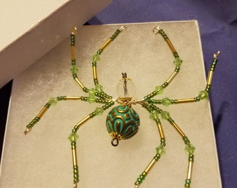 Spider brooch in shades of green