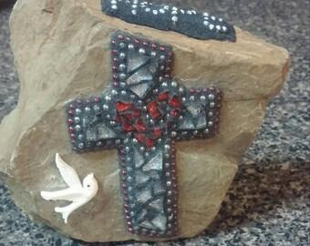 Religious garden stone mosaic