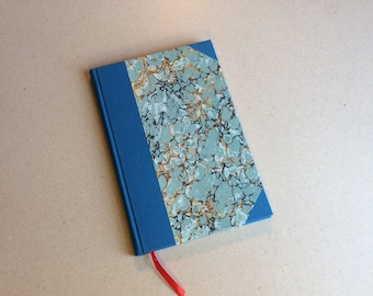 Hand bound A5 blank Journal notebook rounded spine with corners blue bookcloth and marble paper hardback bookbinding gift