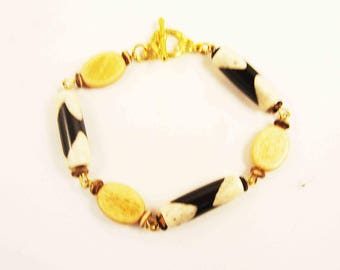 """Handcrafted Bone and Horn Gold Plated 7"""" Bracelet.  Brown & White Bone Hairpipes and Tea Dyed Bone Ovals w/ Heart Toggle Clasp"""