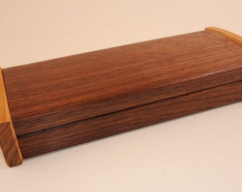Curved top valet box in walnut and hickory