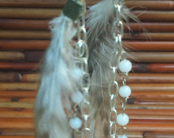 Feather earrings with adornments