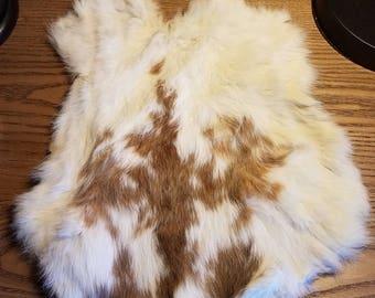 Brown and white rabbit fur pelt