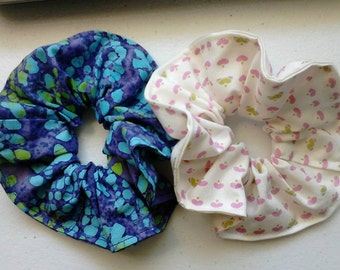 Scrunchies! Two for Ten ;) Dollars that is :) Scrunchie 1. Batik blue, purple and lime & Scrunchie 2. Ivory, pink and green hearts.