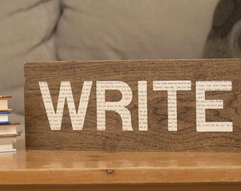 "Wood and book ""Write"" sign"