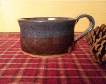 Floating blue pottery soup mugs,  pottery soup mugs,  pottery soup bowls, pottery bowls,  pottery coffee mugs,  coffee mugs