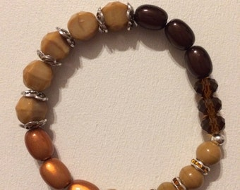 Bracelet beads faceted beige and Brown.