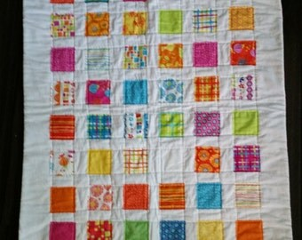 Bright and happy crib sized quilt