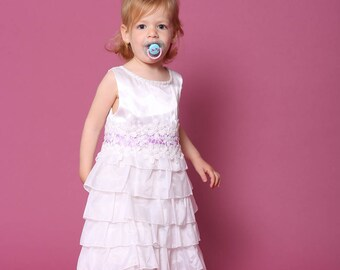 My first flower girl dress. White layers dress decorated with lace, purple ribbon and flower beads.