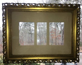 Antique gold carved wood frame with old glass