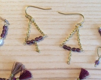 Hanging earrings, purple coloured beads, gold chain, triangle
