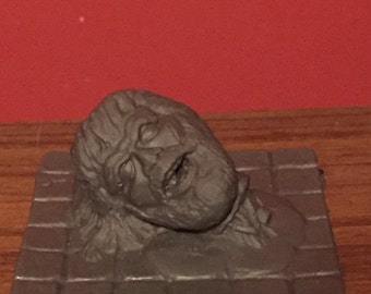 Diorama Severed head on tile, Unpainted. Diorama 1:12 scale