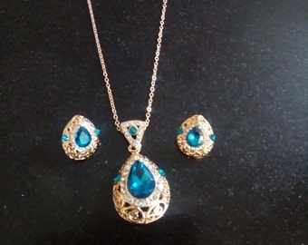 Gold and topaz necklace and earrings