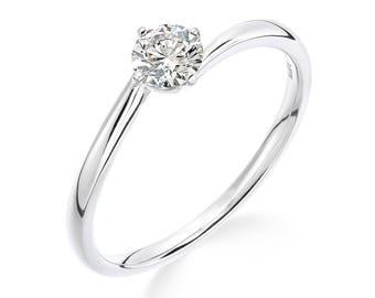 platinum diamond solitaire ring -slight crossover