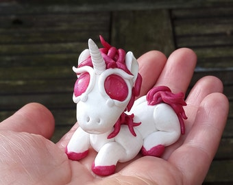 Polymer clay unicorn, pony.  Pink and white.