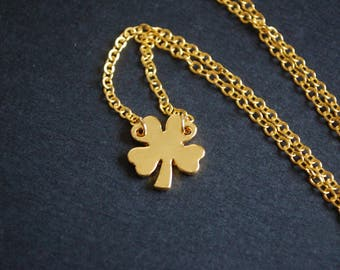 Gold tone four leaf clover necklace