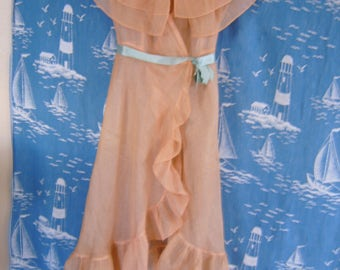 whimsical dress/vest/duster in pale apricot . . .  a study in large ruffles