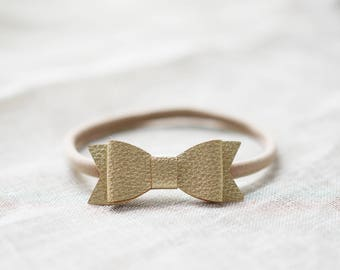 Shimmer gold faux leather bow on elastic headband