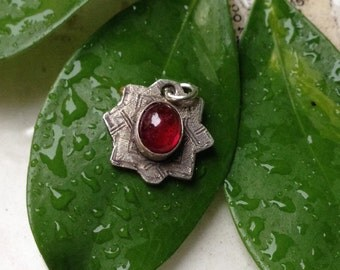 Fine Silver Oval Cabochon Ruby Pendant in Etched Star