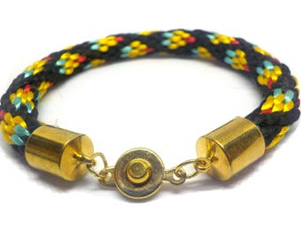 Black with many colors bracelet that is Kumihimo braided