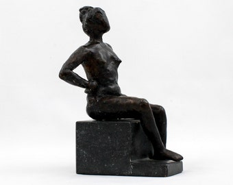 seated woman with arms in it