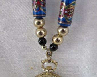 Pendant watch  on cobalt blue painted bead stately long necklace