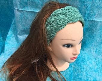 teal/green earmuffs