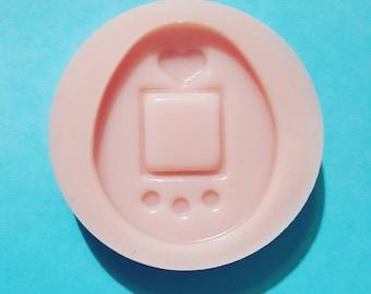 Flexible silicone mold Tamagochi semi gloss (random color)
