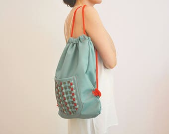Backpack made of leather with braided strips / mint Red