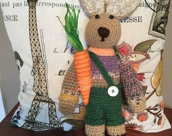 Knitted rabbit with a carrot