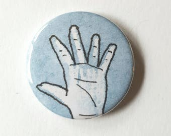 Blue hand pin badge