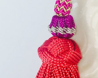 Silk and beads tassel earrings.