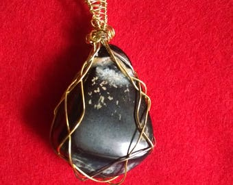 Black shiny agate gold wire wrapped pendant