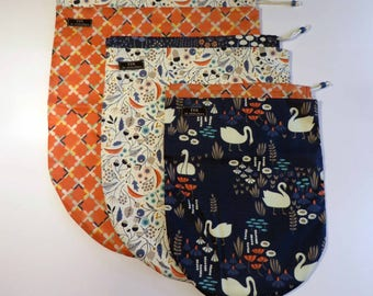 set of drawstring travel or project pouches